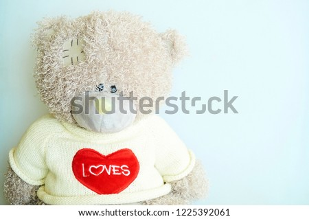 Teddy bear with red heart on gray background with copy space #1225392061