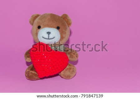 Teddy bear with red heart on pink background for valentine concept,copy space. #791847139