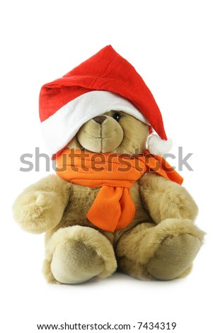 Teddy bear with Santa hat isolated over a white background