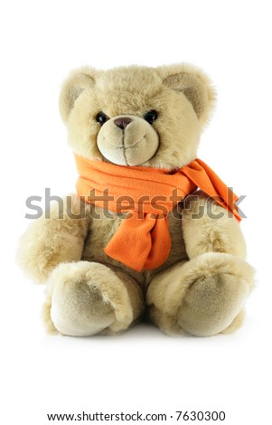 Teddy bear with scarf isolated over a white background