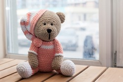 Teddybear toy knitted in the technique of knitting amigurumi.