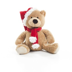 Teddybear with christmas hat and scarf over white background