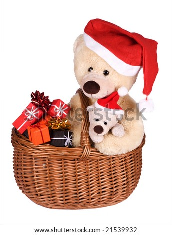 Teddybears in Santa's red hat with gift boxes - stock photo