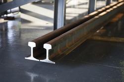 tee or flat bottom steel rails in factory yard