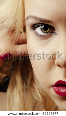 teen aged girl shot in the studio with a dark background and moody lighting