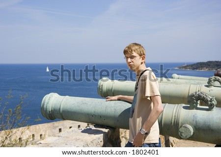teen as a gunner or as cannon fodder - citadel of saint-tropez, french riviera, mediterranean sea