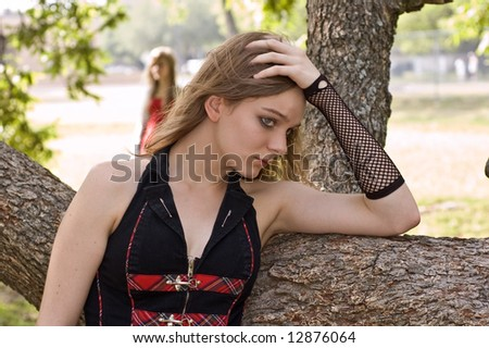 Teen at risk, a young gothic teen girl feels rejected by society