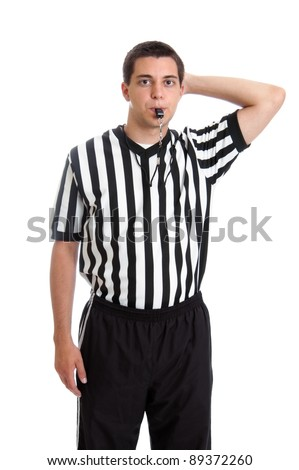 Teen basketball referee giving sign for offensive foul