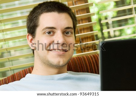 Teen boy at home on the laptop