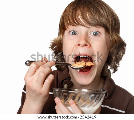 stock photo : Teen boy eating cereal