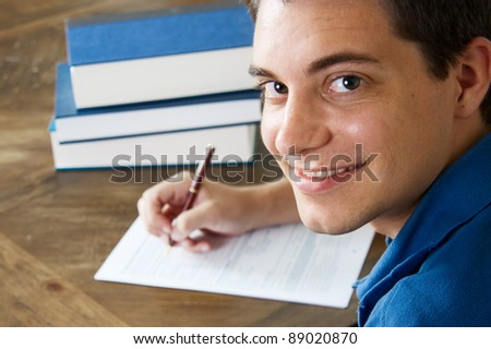 Teen boy filling out a college application