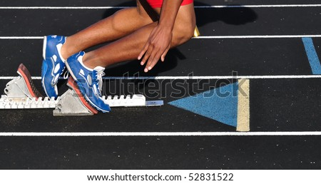 Teen Boy Leaving the Starting Blocks at the Start of a Race