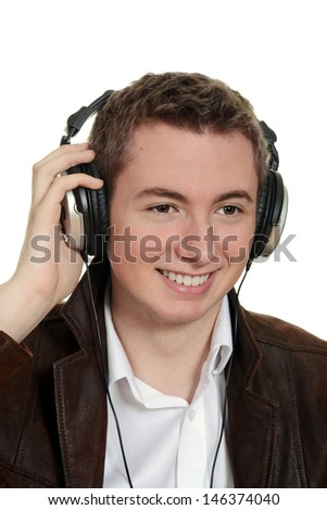 teen boy listening to music with headphones