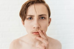 Teen boy looks at his first mustache, puberty period, early adulthood