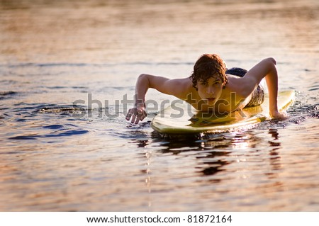 teen boy on a surf board