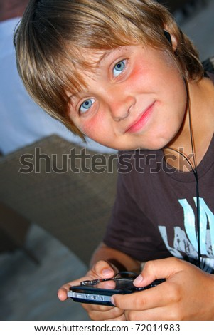 ... -photo-teen-boy-playing-video-games-with-portable-device-72014983.jpg