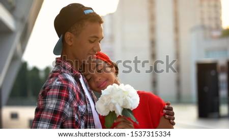 Teen boyfriend giving flowers to girl, congratulating on birthday, romantic date #1537315334