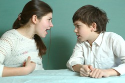 teen brother and sister sibilngs boy and girl arguing close up photo
