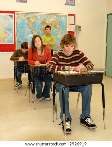Teen Cheating in Class with Teacher Watching