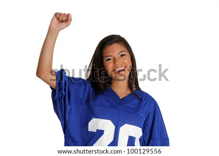 Teen cheering for her team in a jersey