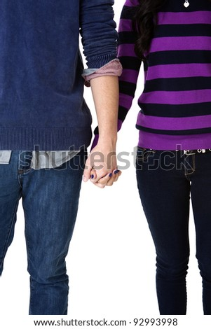 teen couple holding hands