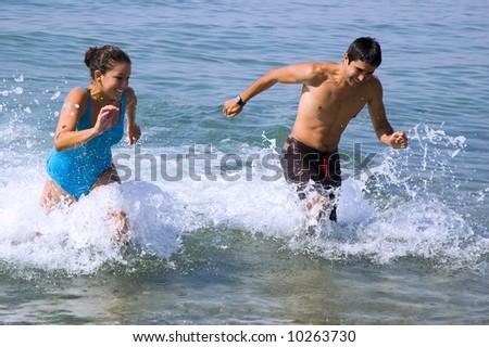 Teen friends racing, enjoying their summer vacation