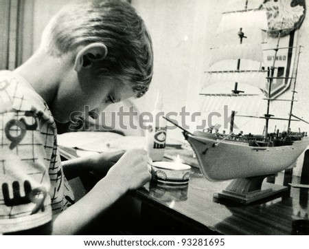 teen gathers model sailboat, Lugansk, Ukraine 1993 (very grainy image)