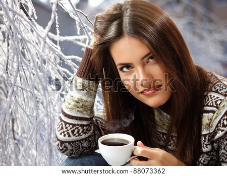 stock photo : teen girl attractive drinking coffee over winter nature ...