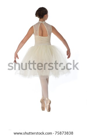 teen girl ballet dancer standing in a tutu in points on a white background