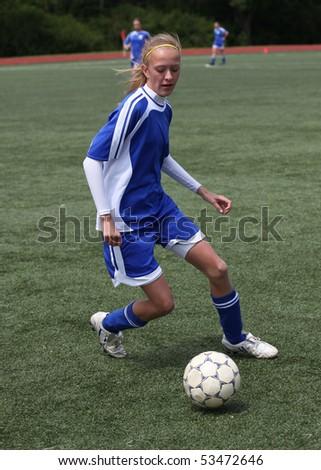 Teen Girl Chasing Soccer Ball - stock photo