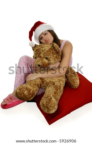 stock photo : Teen girl day dreaming. Sitting in pj's, wearing santa hat and