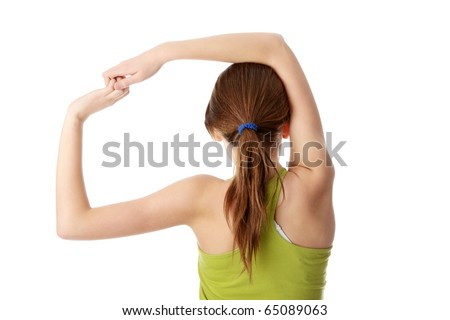 Teen girl exercising isolated on white background - stock photo