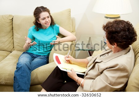 Teen girl expressing frustration in a session with her therapist.