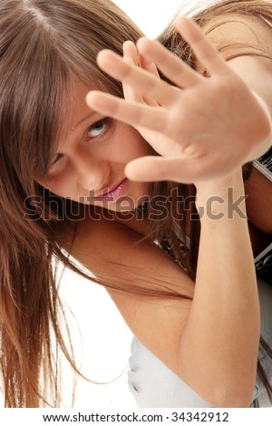 stock photo : Teen girl frighten, covering her face - abuse crime concept