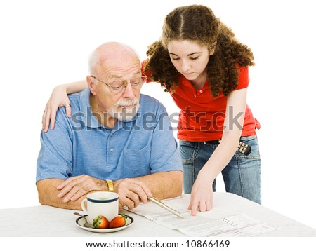 stock photo : Teen girl helping her vision impaired grandpa read his ...