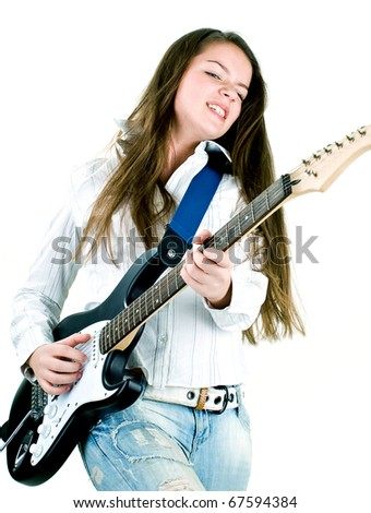Teen girl holding a guitar like a rock star