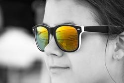 teen girl in sunglasses outdoors