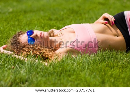 Teen Girl Laying In Field Stock Photo 23757761 : Shutterstock