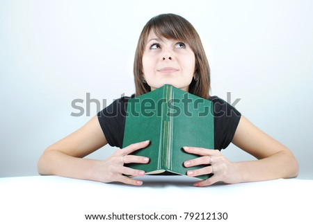 Teen girl learning at the desk, looking up
