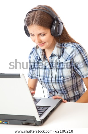 Teen-girl listen to music in headphones with laptop. Isolated on white background