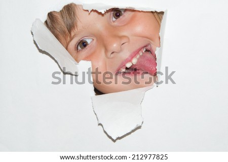 teen girl look from hole in white paper