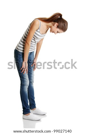 Teen girl looking down. Isolated on white