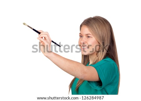 Teen girl painting something with a brush isolated with white background