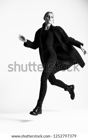 Teen girl posing in the studio. Movement, dynamics.