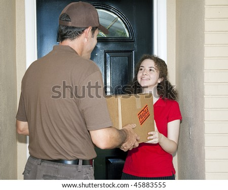 Teen girl receives package from friendly delivery man.