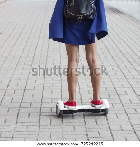 teen girl rides a gyroscope on the street