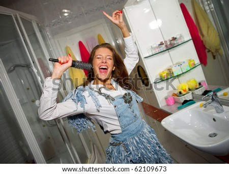 teen girl singing in the bathroom
