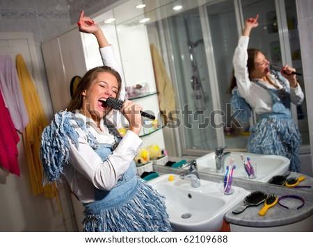 teen girl singing in the bathroom