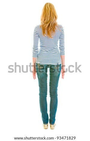 Teen girl standing  back to camera
