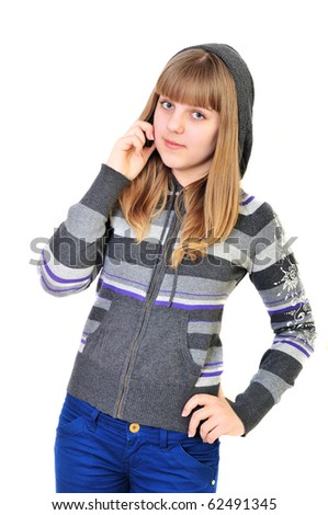 teen girl talking by mobile phone over the white